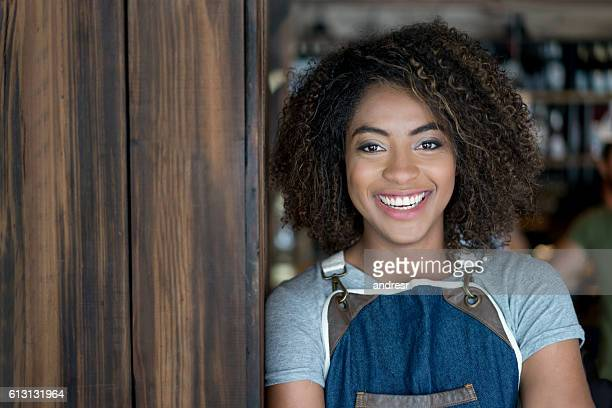 Happy woman working at a restaurant