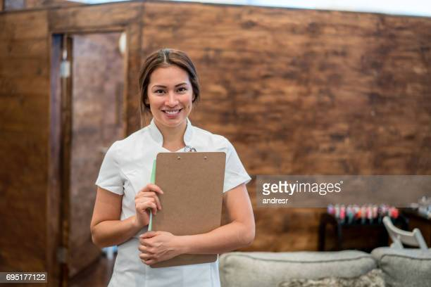 Happy woman working at a spa