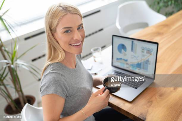 Happy woman working online at home