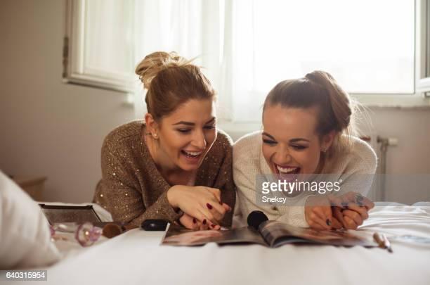 Happy Women applying makeup in bedroom
