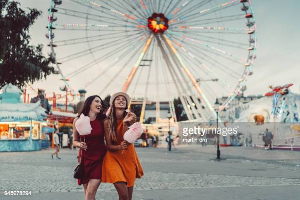 happy women at the amusement park - ferris wheel stock pictures, royalty-free photos & images