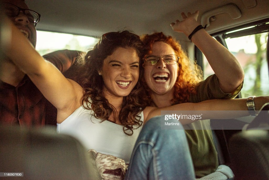 Happy Women Couple Travelling By Car High Res Stock Photo Getty Images