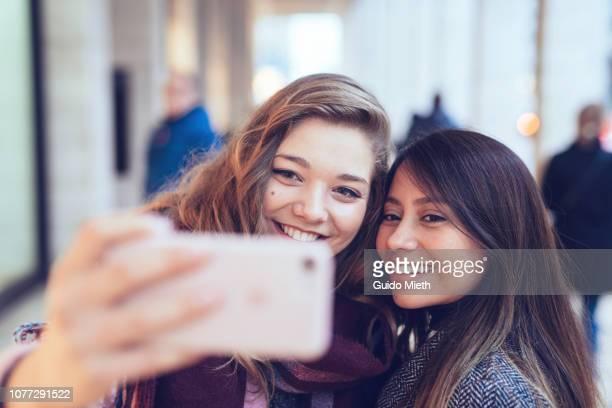 Happy women doing selfie in the city.