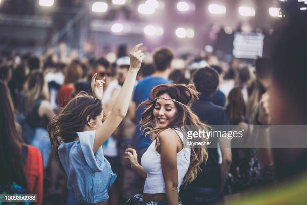 happy women having fun while dancing on a music festival. - music festival stock pictures, royalty-free photos & images