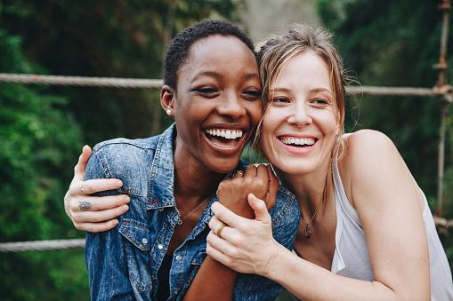 Happy women hugging each other 929930552