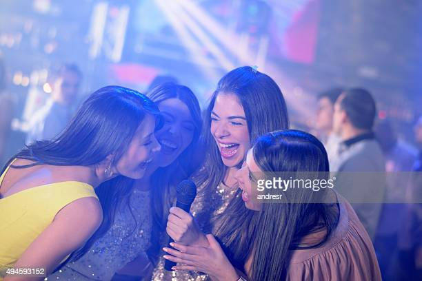 happy women karaoke singing - ladies' night stock pictures, royalty-free photos & images