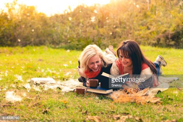 Happy women reading book