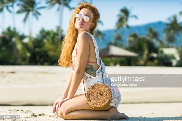 Happy women red hair on the beach