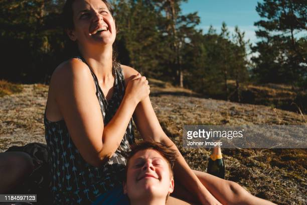 happy women relaxing outdoor - heterosexual couple stock pictures, royalty-free photos & images