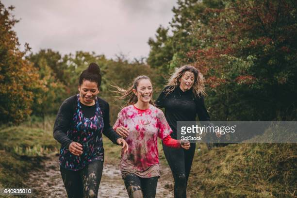 happy women running - sports team event stock photos and pictures