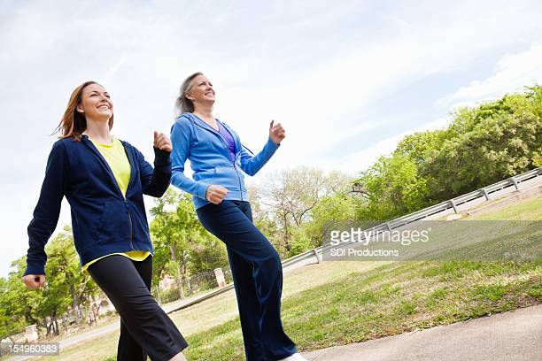 Happy Women Running Together on a Trail