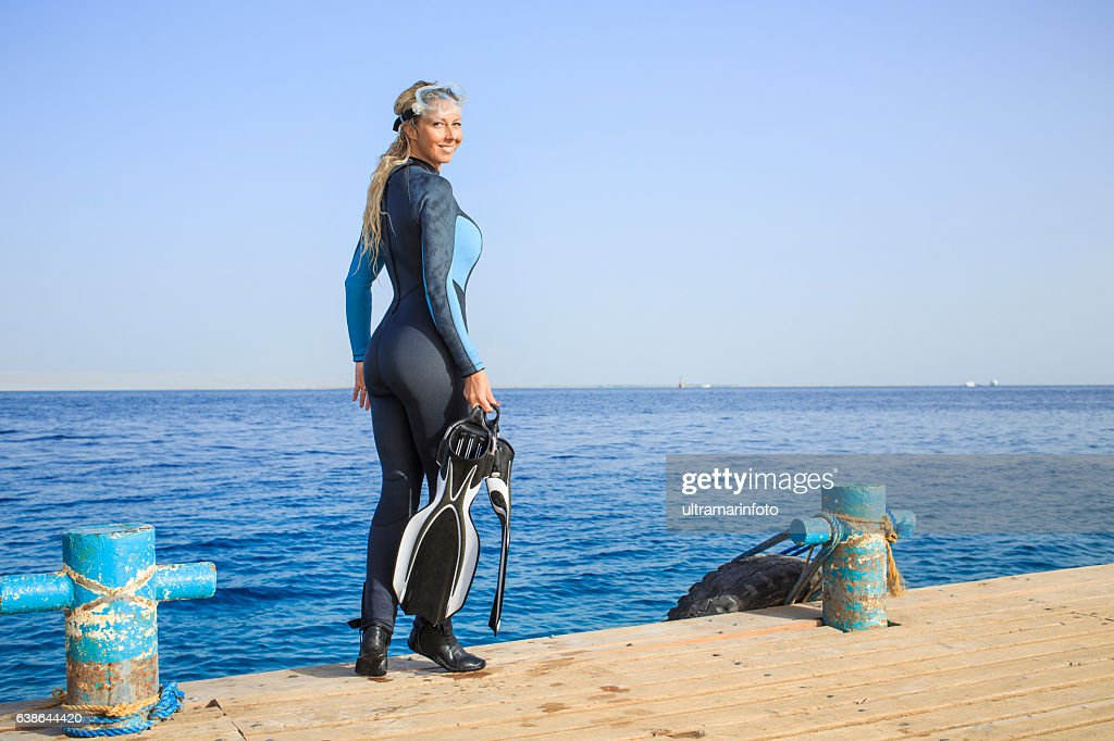 Happy Women Scuba Diver Enjoying In The Sea High-Res Stock Photo - Getty Images-3999