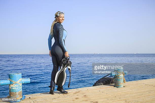 Happy women scuba diver enjoying in the sea