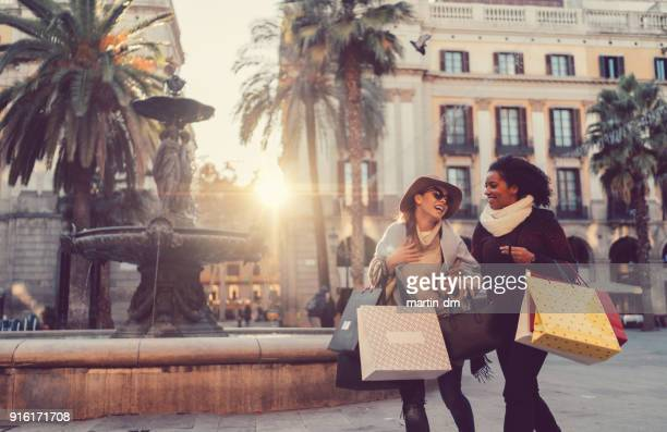 happy women shopping in barcelona - barcelona spain stock pictures, royalty-free photos & images