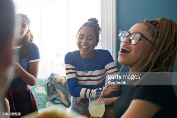 Happy women singing at home