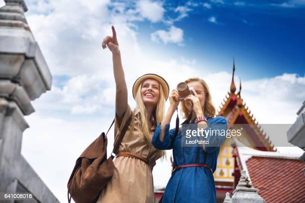 happy women tourist discovering the city - pointing at camera stock photos and pictures