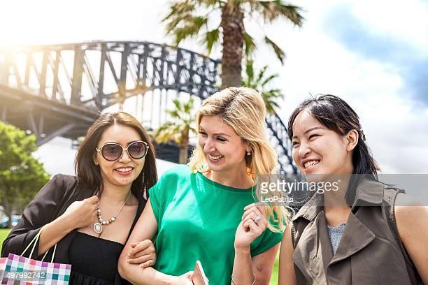 Happy women walking in Sydney downtown
