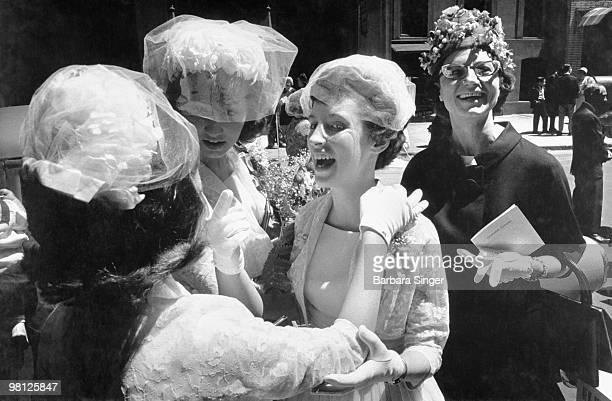 Happy women wearing milliner hats