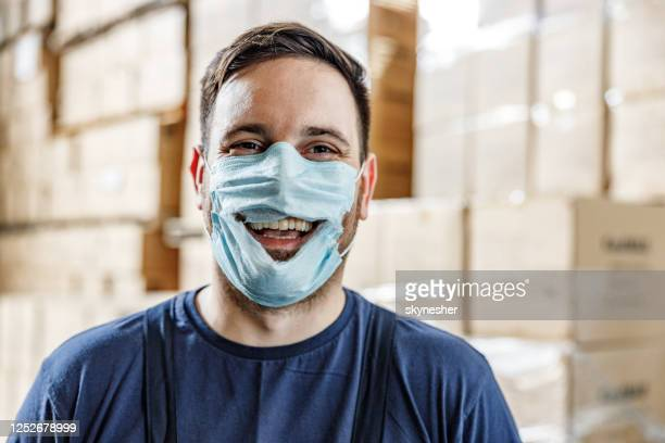 happy worker showing concept of anti-mask protest. - conspiracy stock pictures, royalty-free photos & images