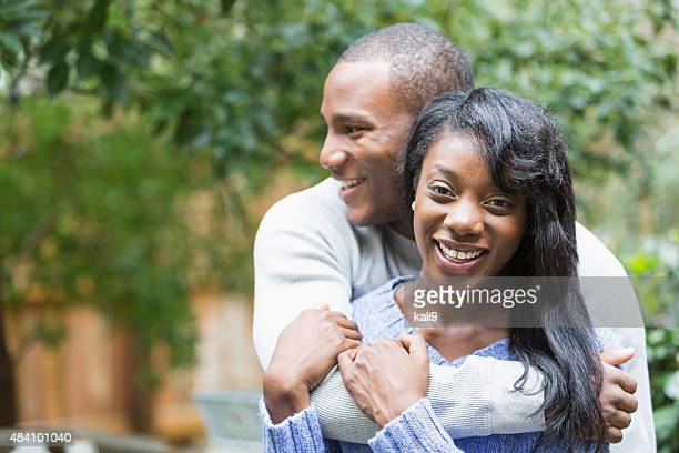 Happy young African American woman with boyfriend