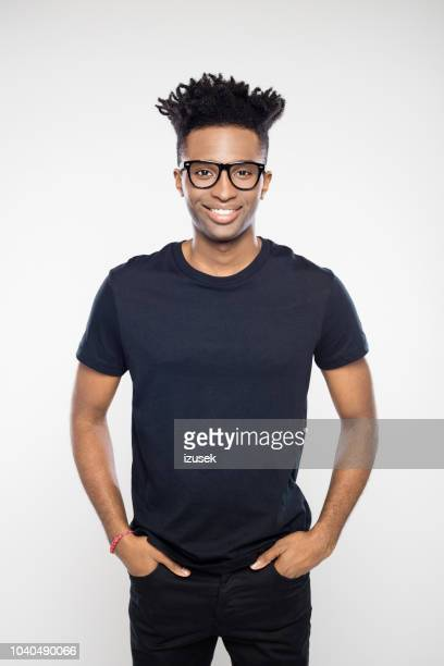 happy young african man in casuals - czech model stock pictures, royalty-free photos & images