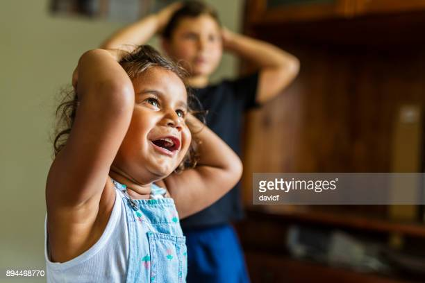 happy young australian aboriginal girl learning to sing and dance to a song - singing stock pictures, royalty-free photos & images