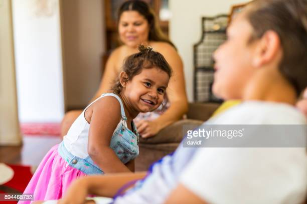 Happy Young Australian Aboriginal Girl Playing at Home