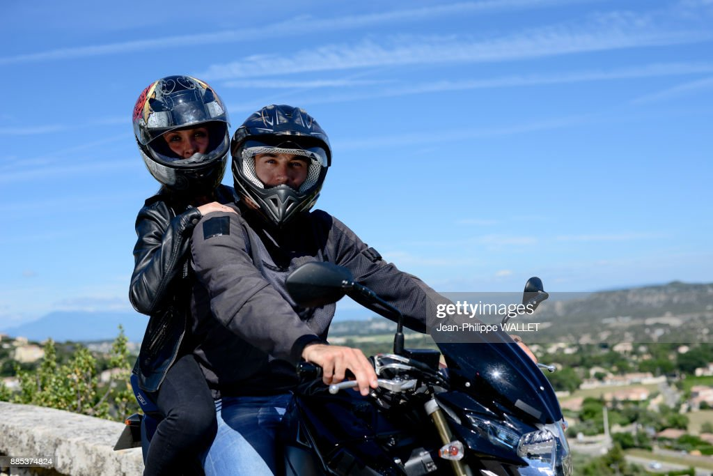 Happy Young Biker Couple Riding Motorbike In Summer High Res Stock Photo Getty Images
