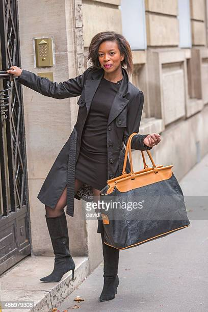 Happy Young Black Woman Leaving Home For Work in Paris