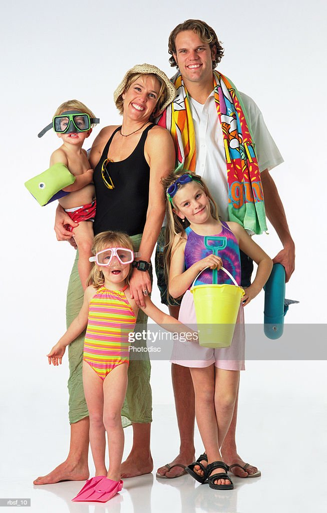 happy young blonde caucasian family of five in swimwear on vacation to the beach : Foto de stock
