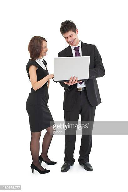 happy young business couple with laptop