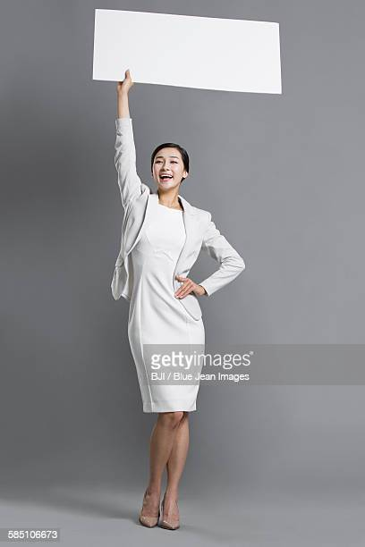 Happy young business person holding a whiteboard
