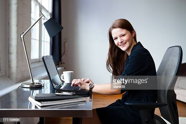 Happy young businesswoman in an office
