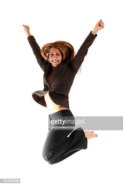 Happy young businesswoman jumping. No shirt, belly and barefoot.