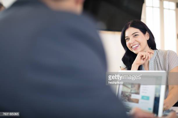 happy young businesswoman working at desk - heshphoto stock pictures, royalty-free photos & images