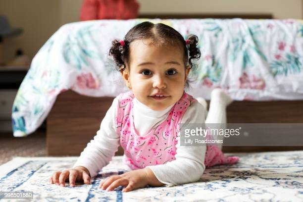 Happy young child in bedroom