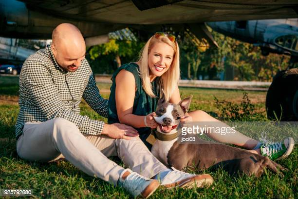 happy young couple and a pet - green skirt stock pictures, royalty-free photos & images