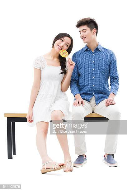 Happy young couple and lollipop