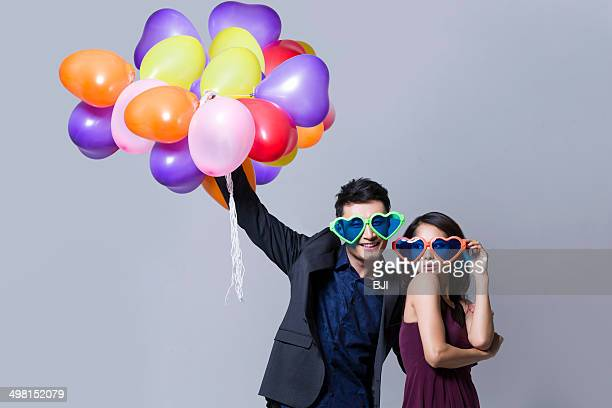 Happy young couple at a party