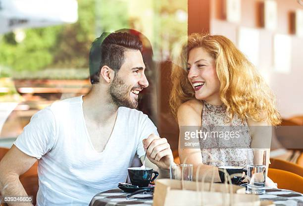 Happy young couple at the coffee bar