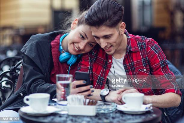 Happy young couple browsing together on the phone
