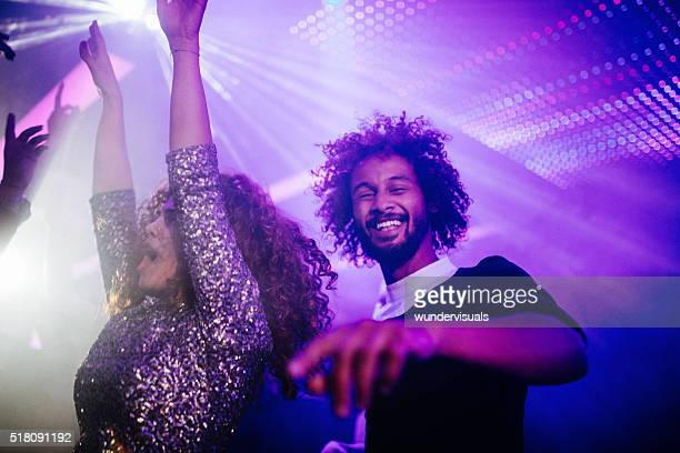 happy young couple dancing in a night club - dance floor stock pictures, royalty-free photos & images