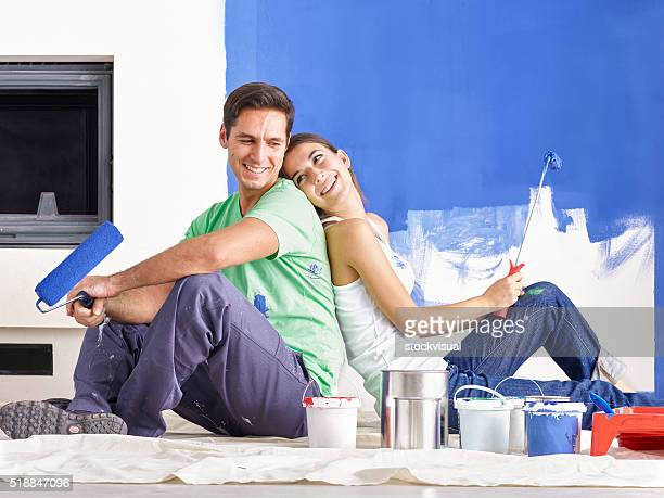 Happy Young Couple Decorating New Home
