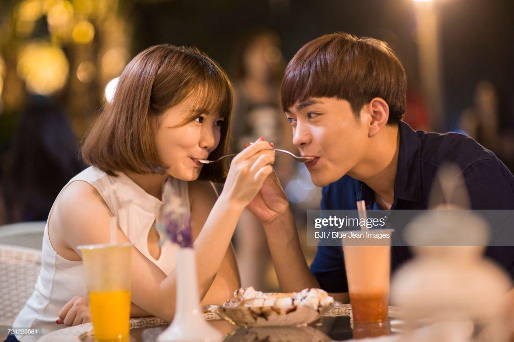 Happy young couple eating ice cream : Stock Photo