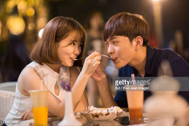 Happy young couple eating ice cream
