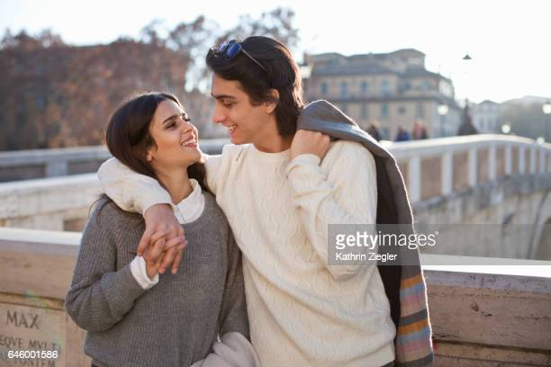 Happy young couple embracing at Ponte Sisto, Rome, Italy