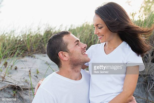 Happy young couple embracing on beach, Delray Beach, Florida, Palm Beach County, USA