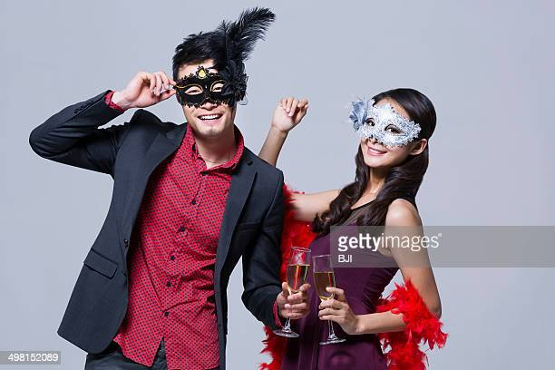 Happy young couple enjoying a fancy party