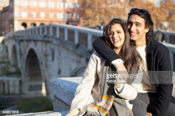 Happy young couple enjoying the sun at Ponte Sisto, Rome, Italy