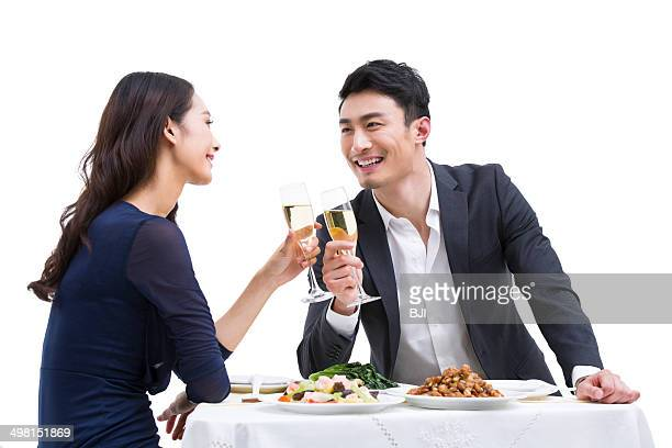 Happy young couple having dinner